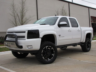 2012 Black Widow Truck http://www.liftedgmtrucks.com/2012/10/2013-chevy-silverado-black-widow-by.html