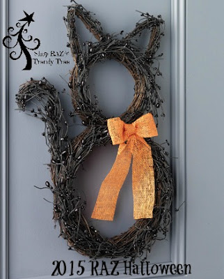 http://www.trendytree.com/raz-christmas-and-halloween-decor/raz-twig-cat-wreath.html
