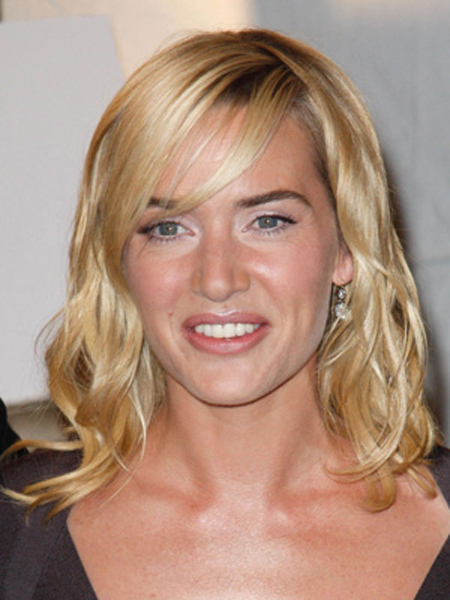 A swoopy bang and bend-y waves give Kate Winslet's hairstyle a seriously sultry look.