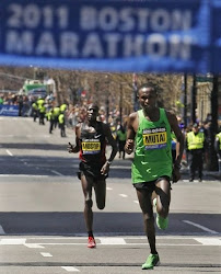 Geoffrey Mutai 2:03:02 n Moses Mosop 2:03:06 became World's fastest  marathoners of all time here