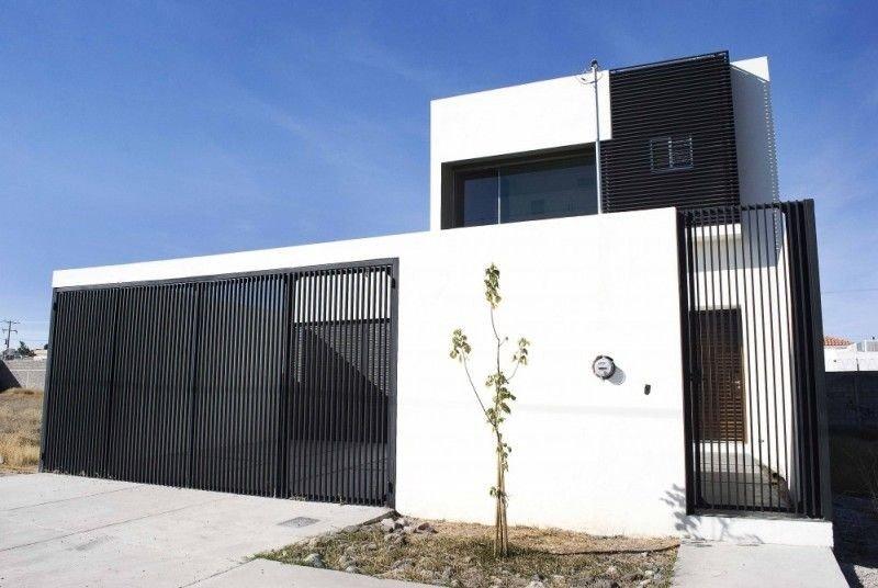 desain pagar rumah minimalis terbuat dari batu alam