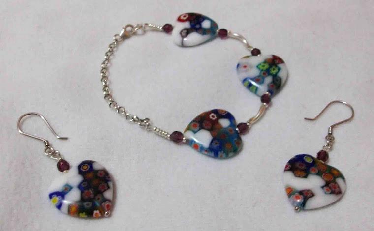 Pulsera corazones con blanco de cristal y aretes plata 950  S/ 75.00 Nuevos Soles / $ 27.00 Dólares