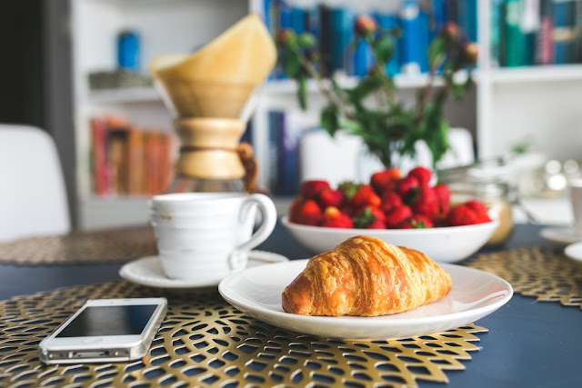 French breakfast with croissant, fruit and tea