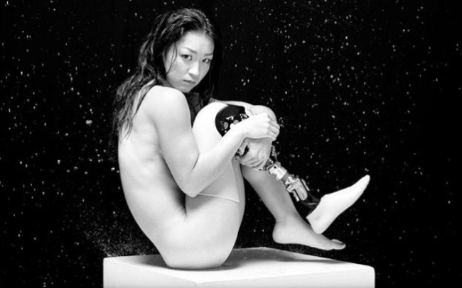 The calendar, with pictures taken by professional photographer Takao Ochi, shows an unclothed Nakanishi striking tasteful poses that ensure just enough of her body is covered.