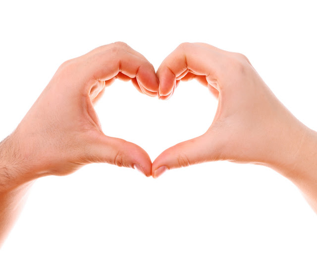 Two hands pressed together to make a heart shape.