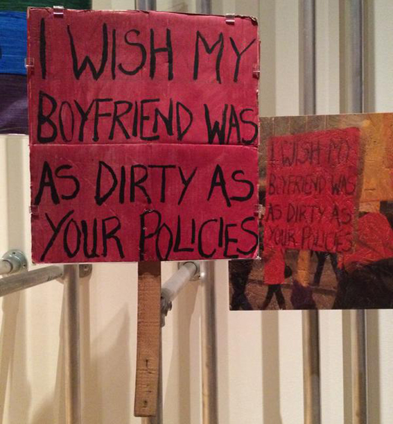'I Wish my Boyfriend was as Dirty as your Policies' protest placard by Carol Stoakes at the V&A