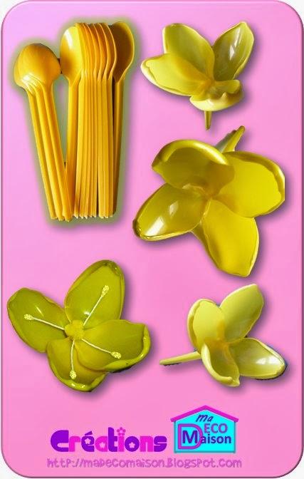 Fleur jaune faite en cuillères de plastique