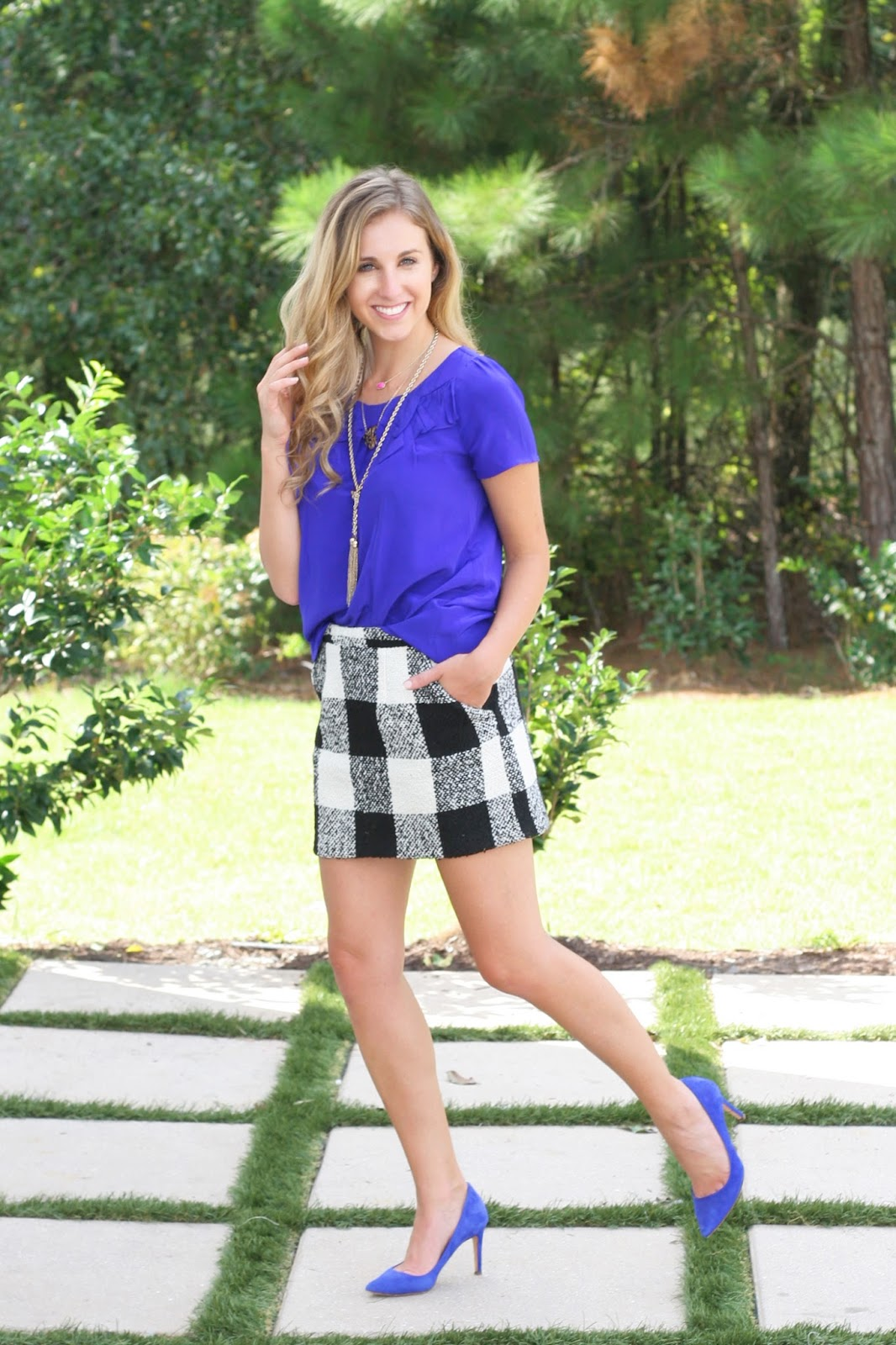 transitional-fall-look-bow-top-effortlessly-tucked-into-printed-wool-skirt