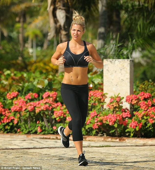 Gemma Atkinson shows off her toned tummy in crop top