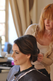 Louise Chrystal working on a bridesmaid's hair on the morning of the wedding.