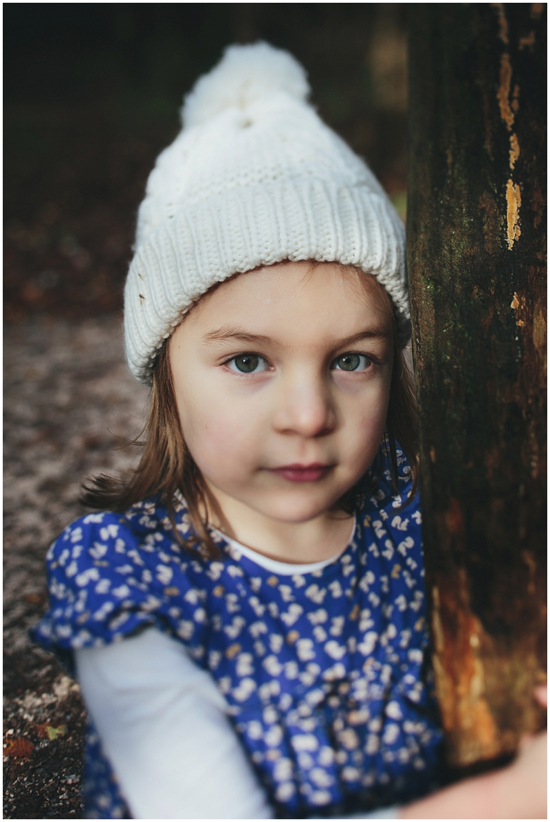Photo of a young girl in a bobble hat