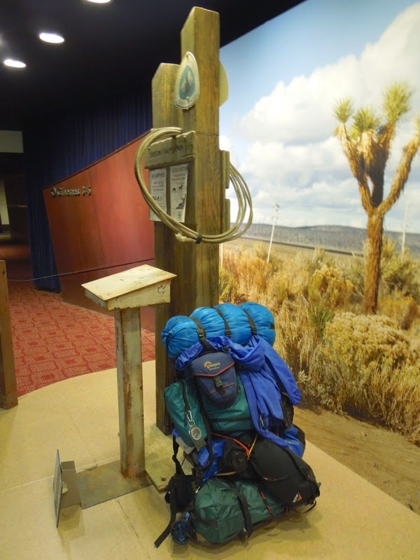Wild backpack and trail sign props