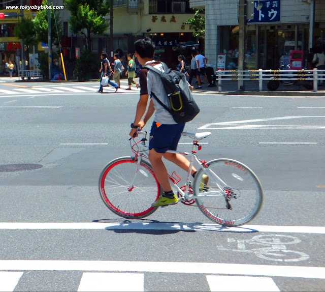 a bicycle commuter in tokyo