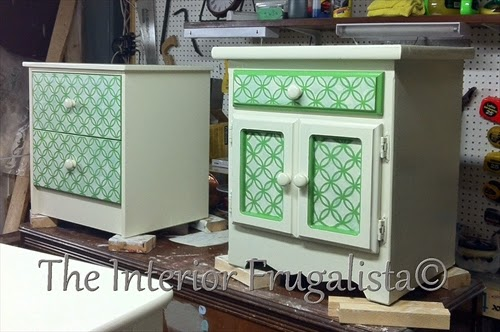 A melamine and a pine side table unified with white paint for night stands.
