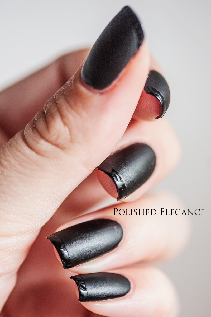 This is two coats of OPI - Lady In Black and one coat of Poshé (from