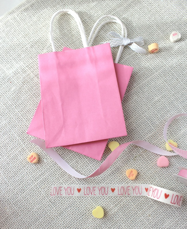 Golden arrows and pink hearts and gift bags