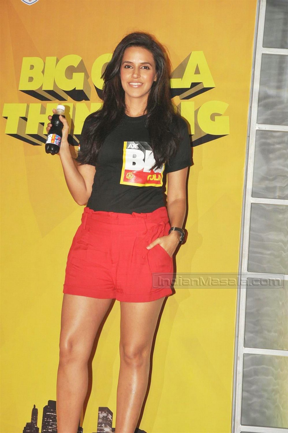 Neha dhupia in red shorts, black top, and a nude wedge heel. We are loving those legs on her.  - Neha Dhupia in red hot shorts -HOT PICS