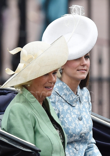 Catherine, Duchess of Cambridge and Camilla, Duchess of Cornwall as they travel in an open state carriage from Buckingham Palace