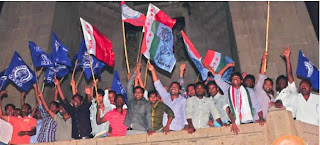 Osmania University students celebrate the Union cabinet nod forseparate state hood toTelangana