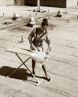 Cindy Crawford ironing on the roof top