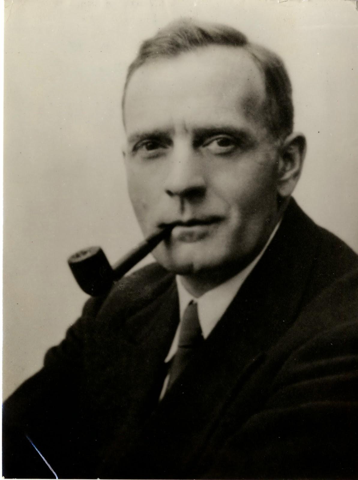 Photograph of Edwin Powell Hubble smoking a pipe