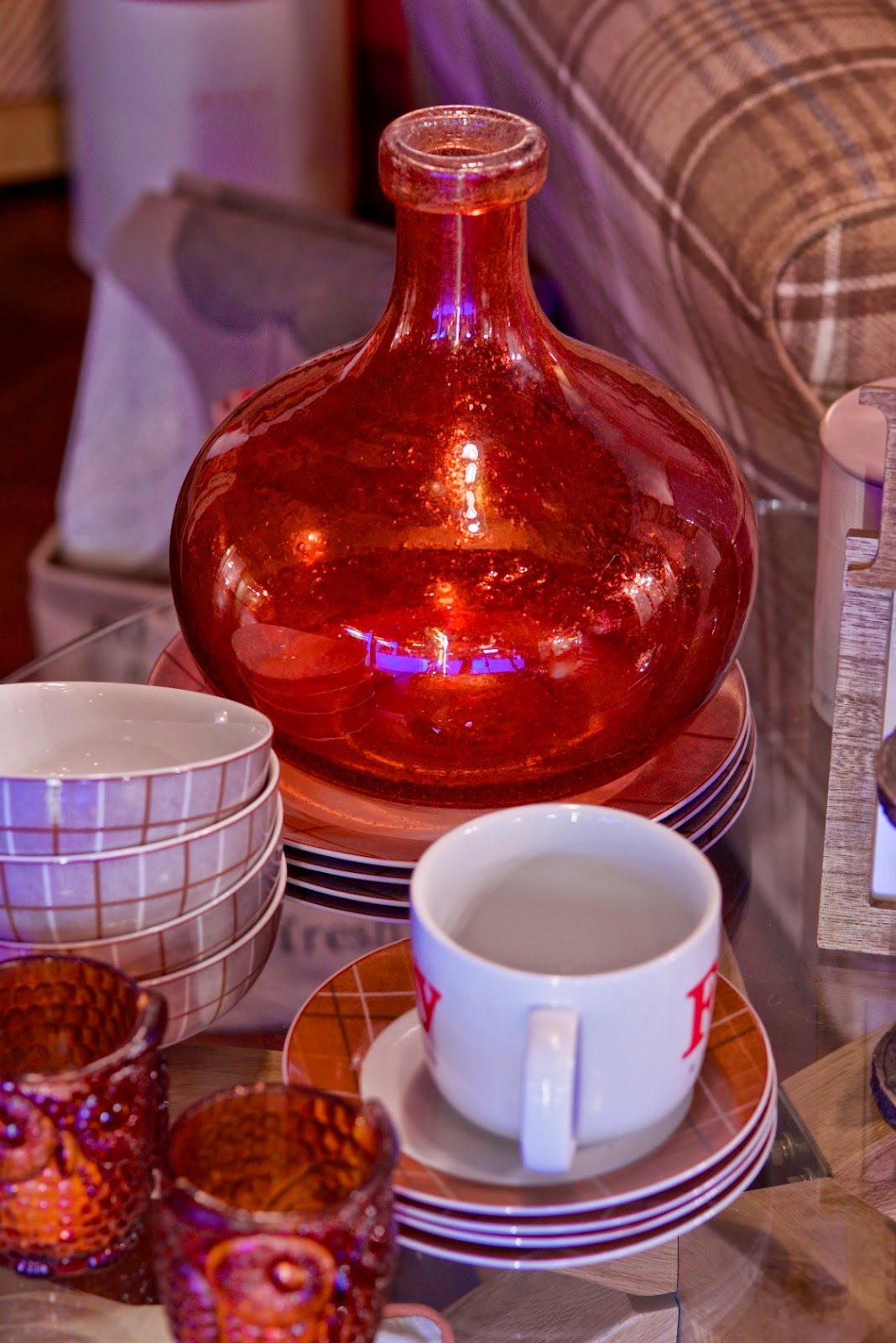 red glass vase and crockery from next