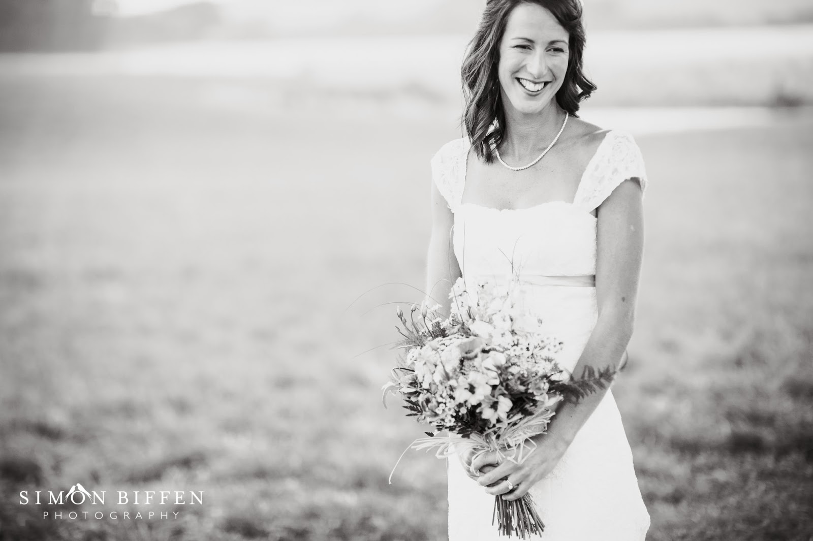 Bride with flowers at Quantock Lakes wedding
