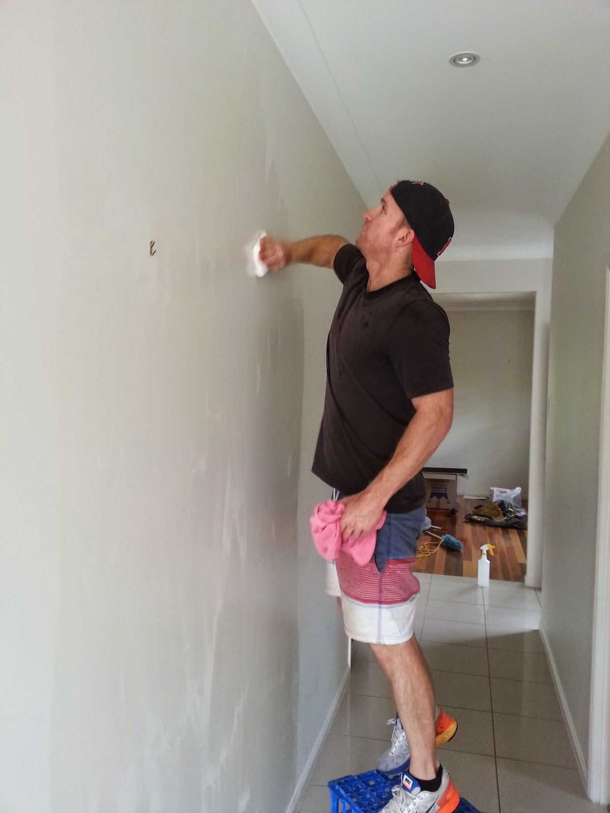 Photo of Man cleaning wall