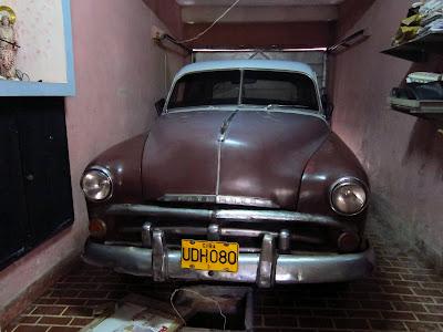 Santiago de Cuba vintage Plymouth in garage