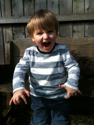 child shouting raaah