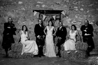 Bride ans groom pose with bridesmaids and groomsmen at bogbain farm