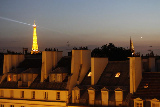 View of Eiffel Tower illuminating the night sky