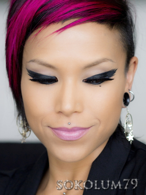 feathered eyeliner and side cut