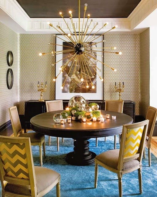 dining room with large gold modern sputnik chandelier