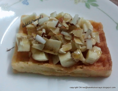 Waffles topped with banana, coconut & almonds
