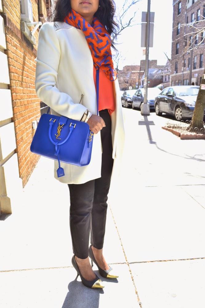 orange and blue orange blouse blue purse
