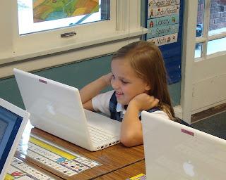 small child using mac laptop