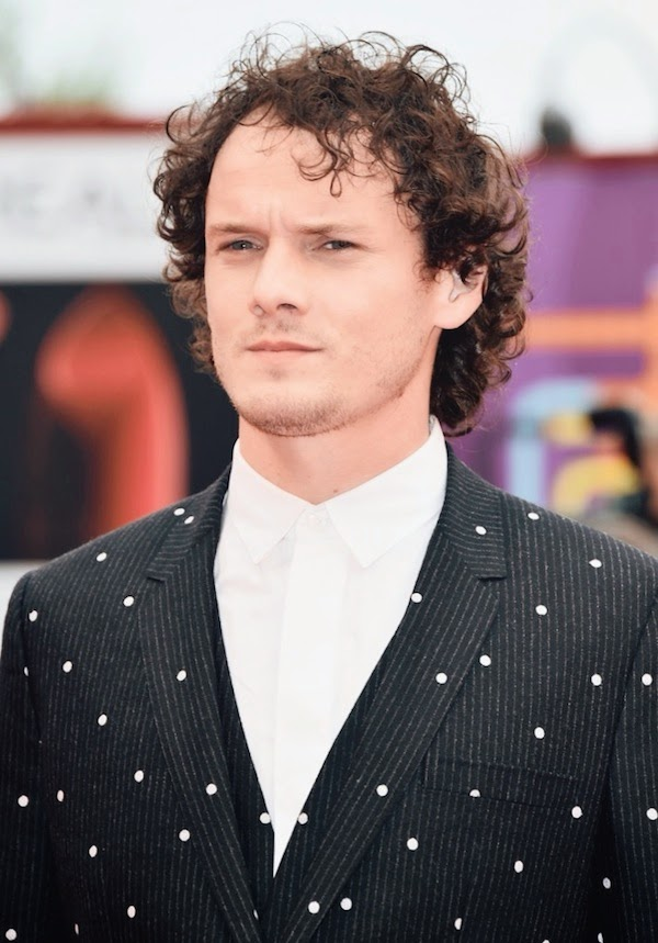 Anton Yelchin wears Dior Homme polka dot black suit at 71st Venice Film Festival 2014