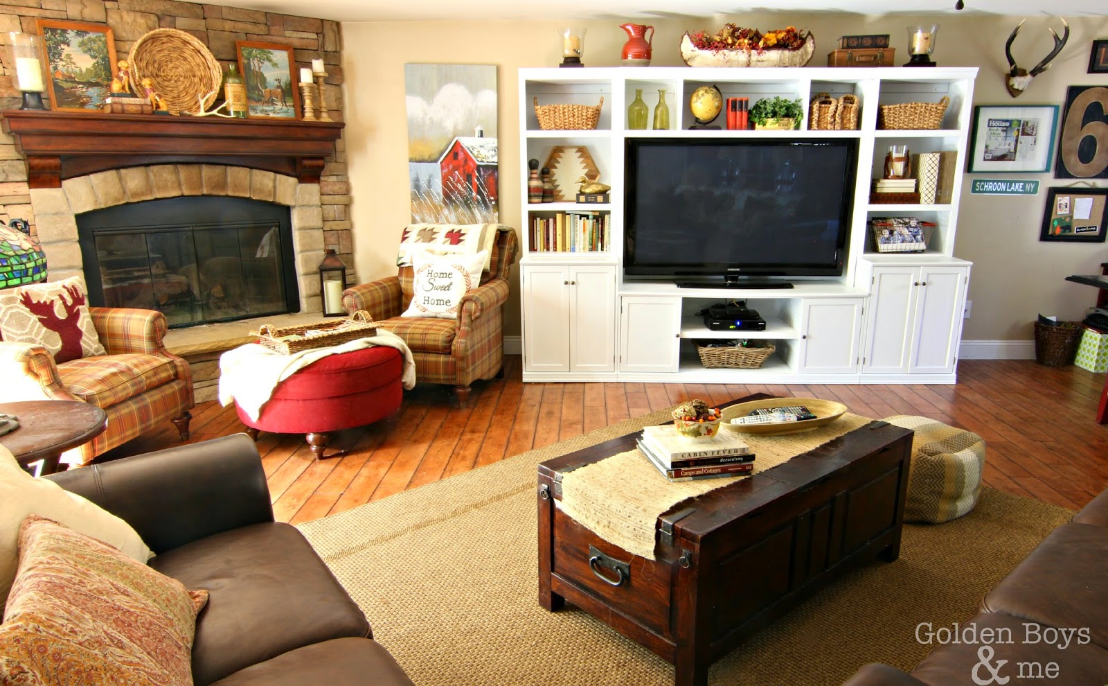 Painted wall unit, crate and barrel trunk style coffee table and Bassett plaid chairs-www.goldenboysandme.com