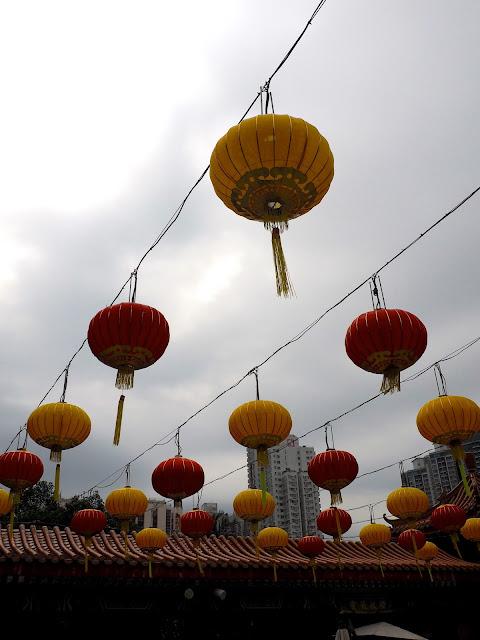 Red & yellow Chinese lanterns hanging above the courtyard of Sik Sik Yuen Wong Tai Sin Temple, Hong Kong