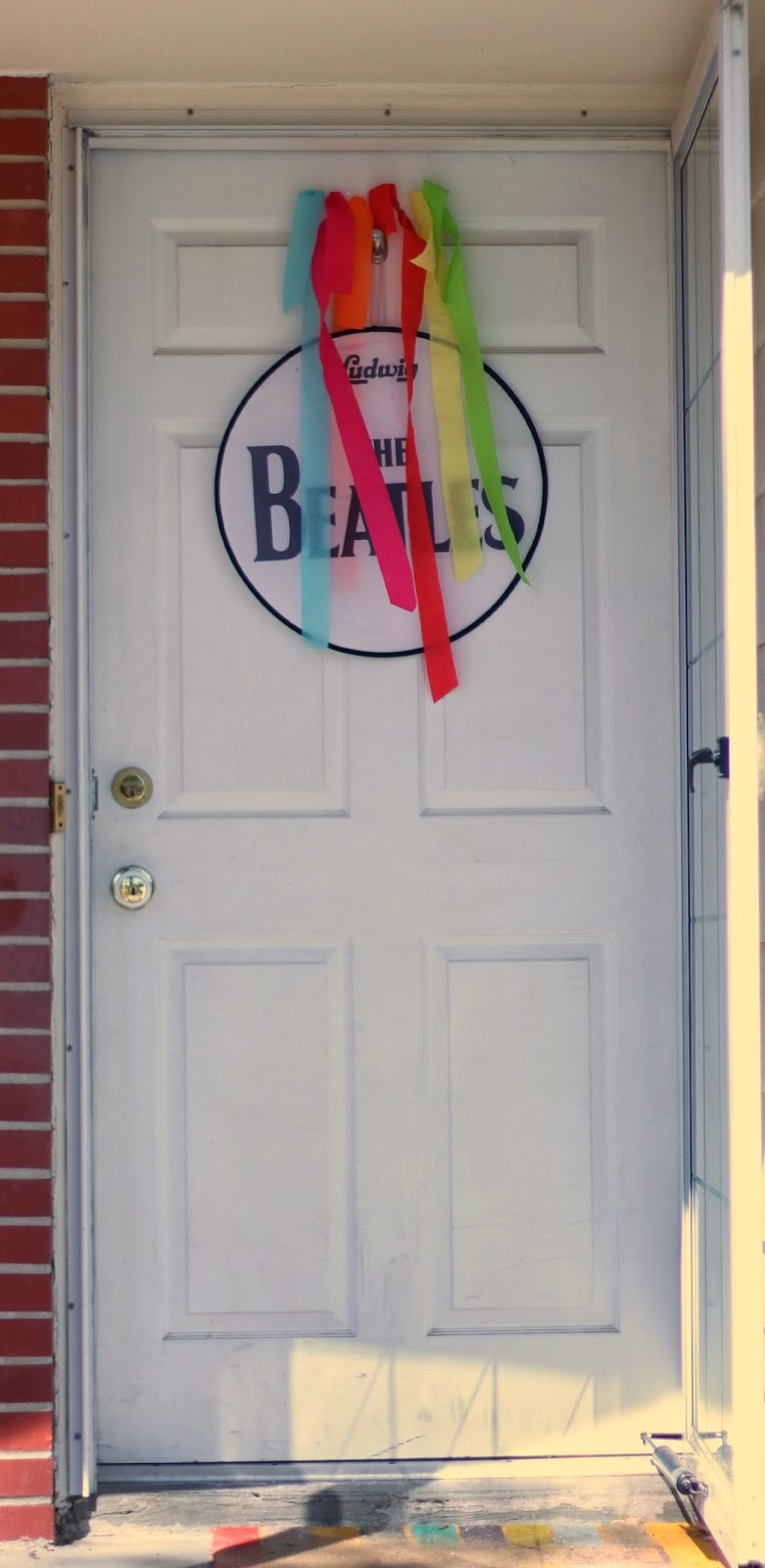 Upon their arrival guests were greeted by some kind of sad streamers and a Beatles sign on the front door. It got better though. : door streamers - pezcame.com