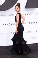 Berenice Marlohe shows off her curves in a black dress