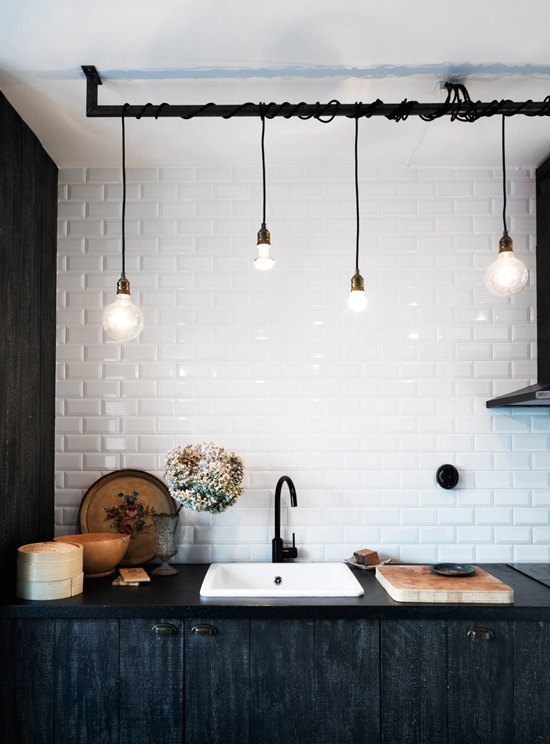 From details like the subway tiles, dark cabinetry, hardware and industrial  lighting the space decorated with inherited and flea ...