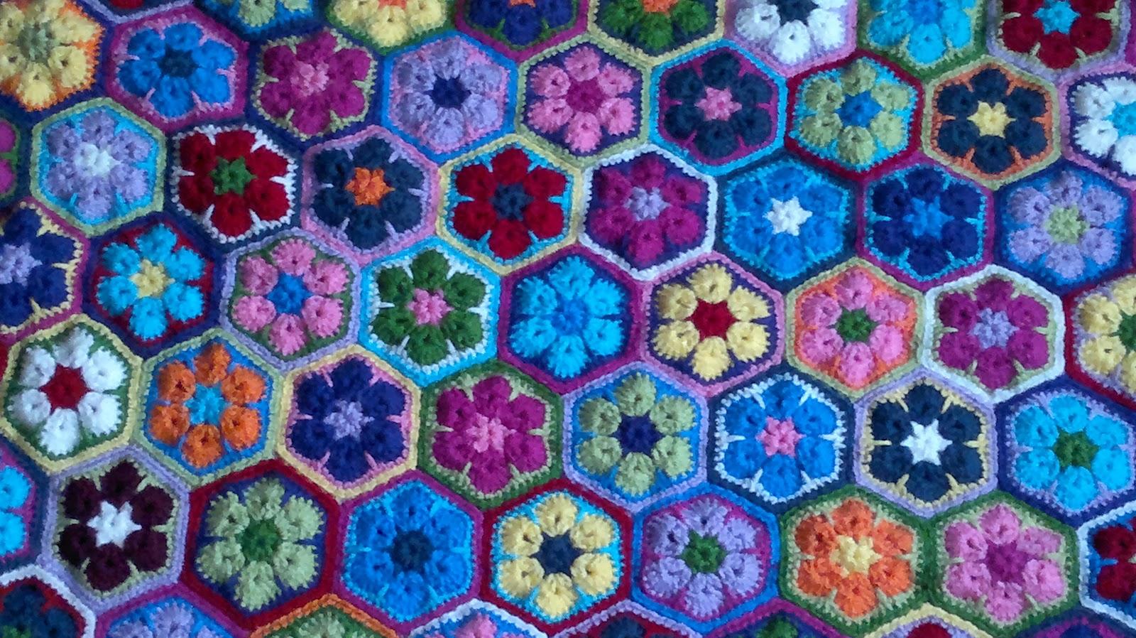 Mis perendengues: Análisis de la manta de flores africanas