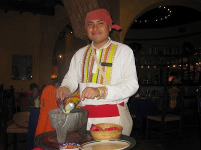 waiter making guacamole