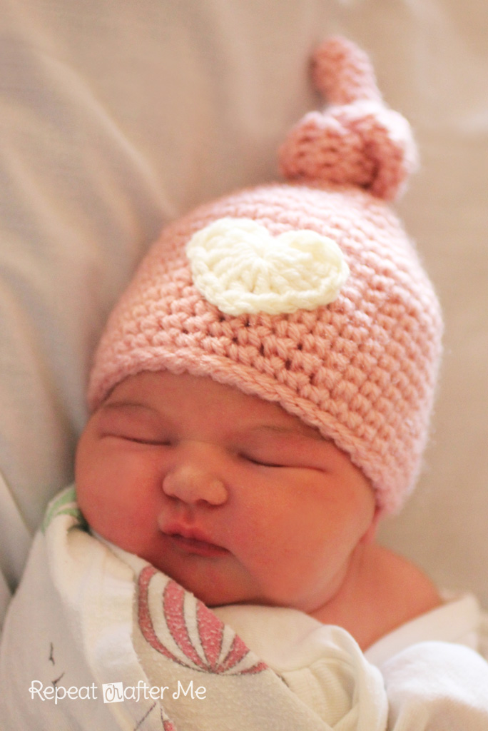 Crocheting Newborn Baby Hat : ... long tail and sew heart onto front of hat with tapestry needle