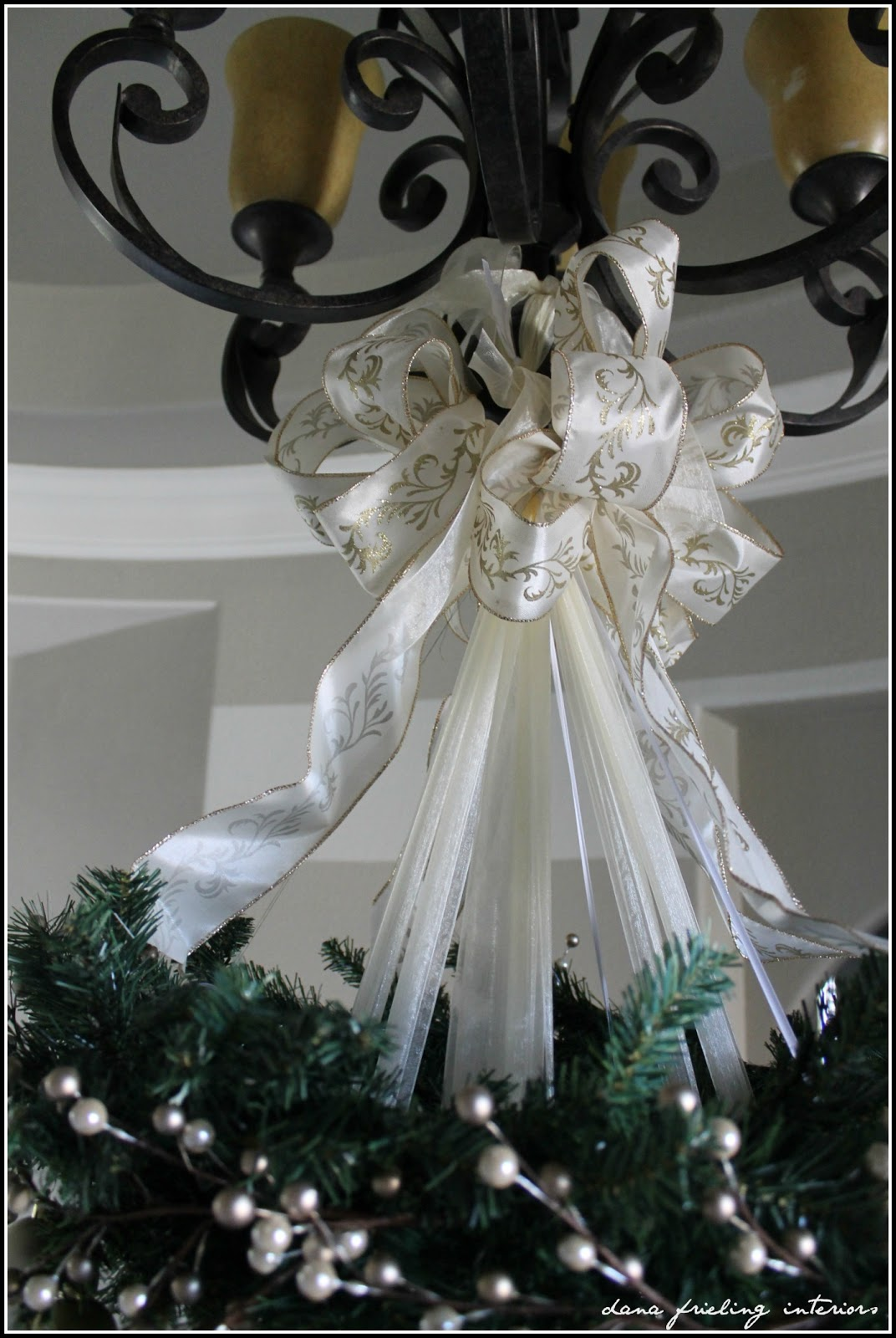Make them wonder hanging christmas tree dont look too close or youll see the hot mess thats hiding under the big bows every ribbon is tied to the chandelier then 2 big bows one on each side arubaitofo Gallery