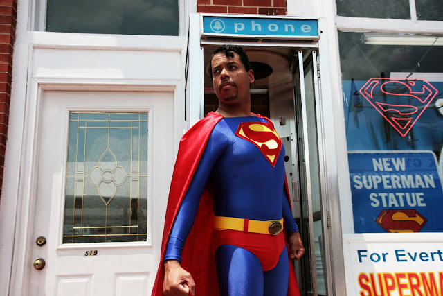 An awesome black Superman coming out of a phone booth during the Superman Celebration in Metropolis, Illinois.