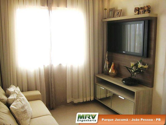 decoracao de sala em apartamento pequeno : decoracao de sala em apartamento pequeno: inferiores em espelho também auxiliam na sensação de amplitude