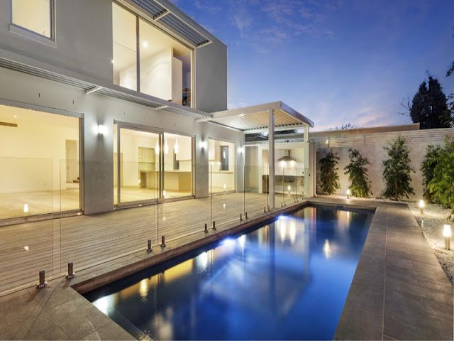 Photo of pool area in the backyard of modern residence in Australia